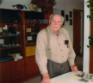 Bill with his rocks in the china cabinet.